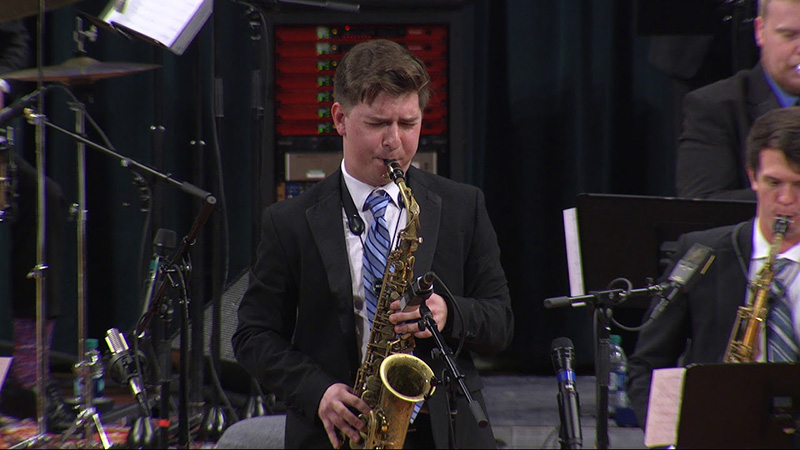 Kyle Myers performing on saxophone