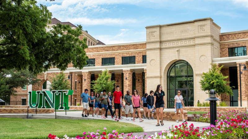 Wide shot of the UNT welcome center in August