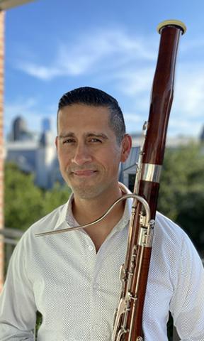 Jorge Cruz Headshot with Bassoon