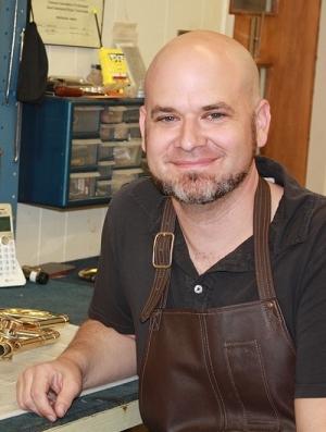 Justin Cooper at instrument repair table