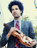 Scott Tixier, holding violin