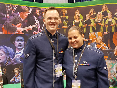 Jay Sutey and Ally (Hany) Albrecht vist UNT booth