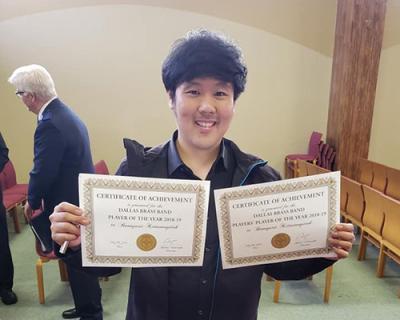 Boonyarit Kittaweepitak photographed with award certificates