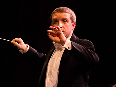 Brandon K. McDonnald conducting