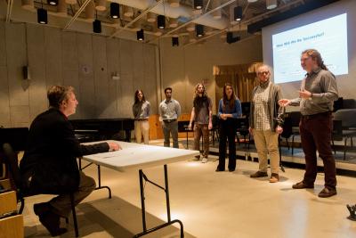 Students presenting in front of Entrepreneurship judge David Cutler