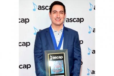 Daniel James Chan posing with ASCAP Award