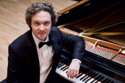Dzmitry Ulasiuk publicity shot while sitting at Piano