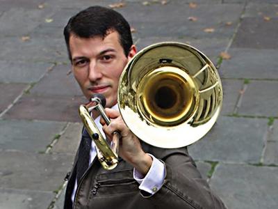 Nick Finzer, holding trombone