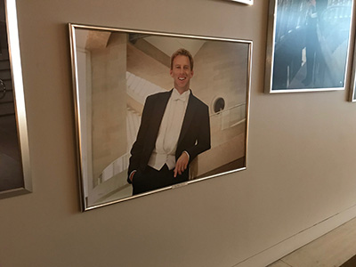 Joshua Habermann's photo posted on the wall of the Dallas Symphony Orchestra