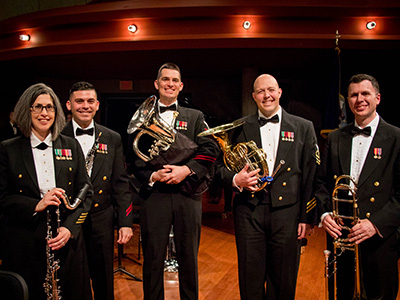 UNT Navy Band Alumni standing with instruments