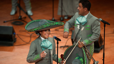 Mariachi Águilas performing on stage