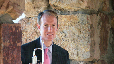Marc Reed seated with trumpet
