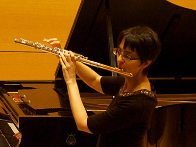 Elizabeth McNutt performing on flute