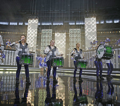 UNT Mean Green Members performing percussion at Dallas Cowboys Halftime Show
