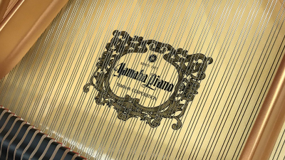 Inside of Yamaha Piano with Yamaha Logo